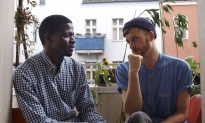 Refugees Welcome co-founder Jonas Kakoschke and flatmate Bakary Conan
